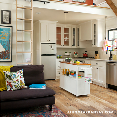 "An ""L"" shaped kitchen is tucked into the corner, with all you need. (athomearkansas.com)"