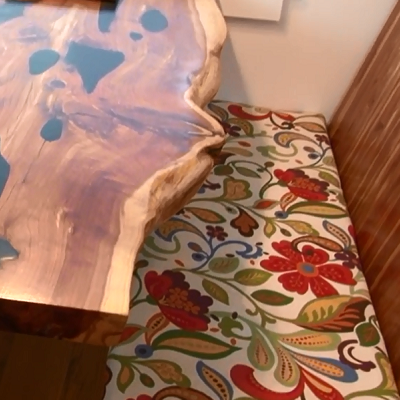 Hand-made table and benches are can seat four. (Youtube, Ben Hartel)
