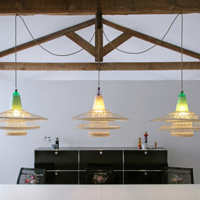 Crafters from Chimbarongo, Chile created lamp pendants from recycled plastic bottles and natural wicker. (PET Lamp)