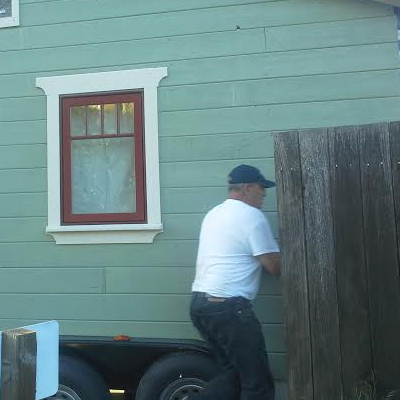 Driver checks clearances before backing up. (Tiny House Joy)