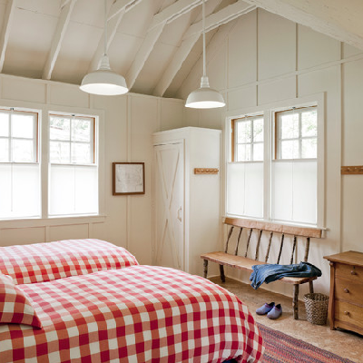 A country-cute bedroom is possible in a tiny cottage! There's plenty of room for two, including a closet, bench and dresser to place your items. (Houzz.com)