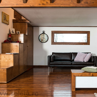 In Bucharest, a special green home has been on display. It offers stairs with five side storage units, leading up to the bedroom. (Soleta zeroEnergy)