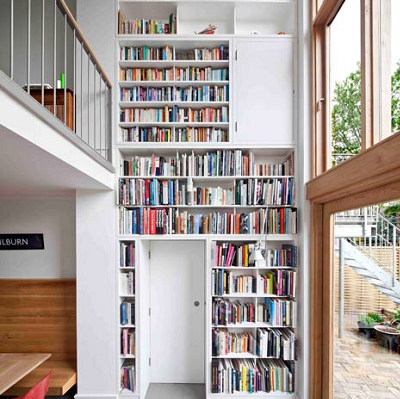 Do you have to give up your library? We like this bookcase wall, enveloping the door and storage. (Dezeen)