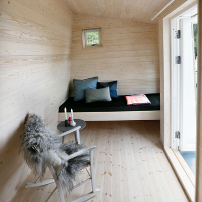 Here's one angled wing for sleeping, plus a little seating area. (Tuvalu Arkitekter)