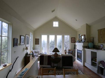 This storybook home is all about light. Upstairs is the great room, with a view towards the sky, sun, trees and valley below. It is arranged with a few simple pieces of furniture and creature comforts. (Bend Bulletin)