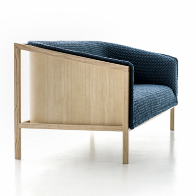 The Prop chair, in blue, has an exposed and curved seat structure in clear view. (Benjamin Hubert)