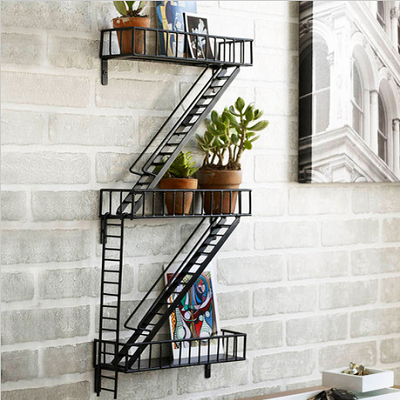 "Book-Escape Wall Shelves are hand-welded and made from epoxy coated steel. They fit small spaces, measuring 3.8""D x 12""W x 25.5"" H. (Dot & Bo)"