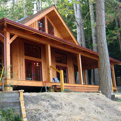 This Washington home is made with energy efficient SIP panels. Its cedar board and batten siding and fir timber work well together. Measures 1,200 sq. ft. (Cascade Joinery)