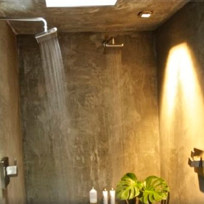 Scott even made the bath area urbane, featuring an elegant spa-like shower room constructed with concrete. (Airbnb)