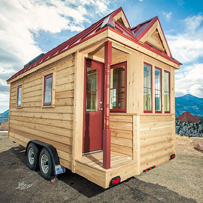 Brand-new Cypress 18 Overlook, with the same cranberry red colored door and windows frames as the two-year old version for sale. (Tumbleweed Houses)