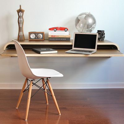 "A floating wall desk, designed by Dario Antonioni, has no legs! Measures 15.8"" D x 36"" W x 9.9"" H. (Orange22)"