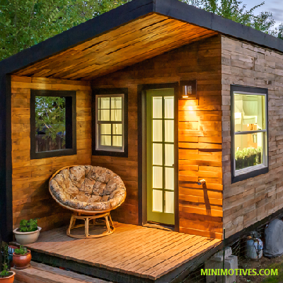 In a tiny house on wheels, one side porch transforms into a jewel box room that adds living space. (Minimotives)