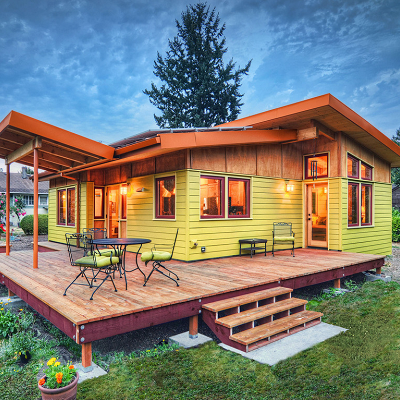 "This single-level deck house received Fine Homebuilding Magazine's Small Home of 2013 Award for ""its shared spaces and connections to the outdoors that make it seem larger."" It has two bedrooms and one bath, in 800 sq. ft. (Nir Pearlson)"