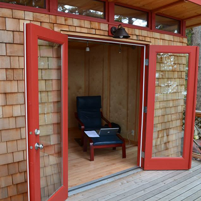 In the San Juan Islands, overlooking the Pacific Ocean, one couple uses a cedar-clad shed. (Modern-Shed)