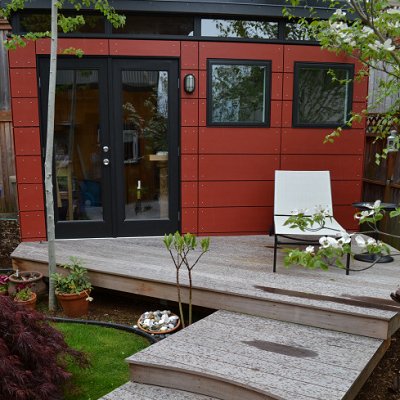 SHED SUPPLIER: In Seattle, a felt artisan was fed up with working in her family kitchen and ordered this craft shed which fits perfectly. she selected the nice red color and added the deck. (Modern-Shed)
