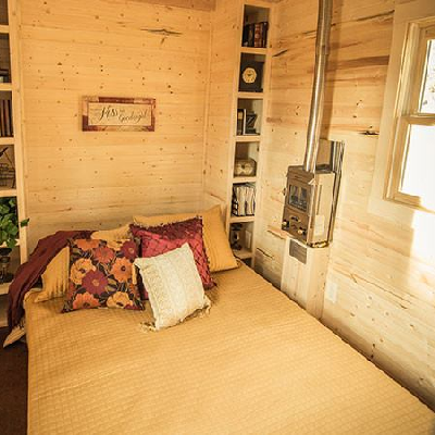 This pull-down Murphy bed, installed in a 20 ft long Cypress tiny house on wheels, sleeps two on the main floor. You don't have to sleep in an upstairs loft! (Tumbleweed Houses)