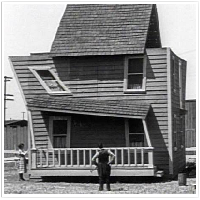Wonder where we went wrong? the newlyweds take a look at their their topsy-turvy house construction. (Sales on Film)