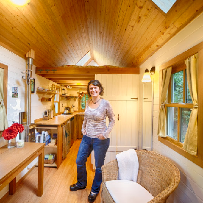 At 130 square feet, this Tumbleweed tiny house feels open with a pitched roofline and windows. It has separate kitchen and great room areas. Book this Olympia, WA house for a night, from Brittany Yunker. (Bayside Bungalow)