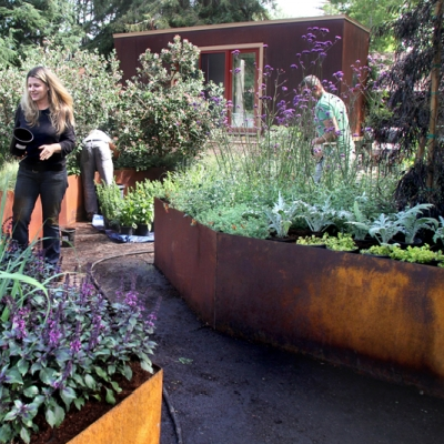 Gardeners are working and adding edible plants to the tiny house yard. How beautiful! (Palo Alto Weekly)