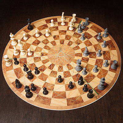 "This round chess game comes with three sets of plastic, felt-bottomed chessmen. Its board measures 1/8"" thick and folds out to a 19"" diameter. (Think Geek)"