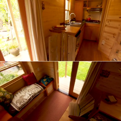 Inside this back yard home, you have a comfortable sleeping loft, kitchen and storage shelves. There's also a nice great room and hang-out area, by the front door. (PAD Tiny Houses)