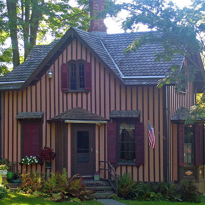 Springside Gatehouse is one of the earliest examples of Carpenter Gothic style, with obvious board and batten use. It is the only known home designed by A.J. Downing, and built after his death in the 1850s. It stands today on landmarked property in Poughkeepsie, NY. (Springside Estate)