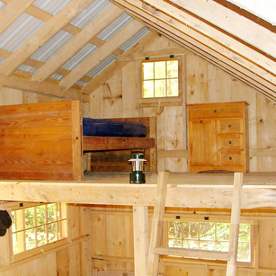 In this cottage, the second floor loft has a bed, dresser and plenty of space. (Jamaica Cottage)