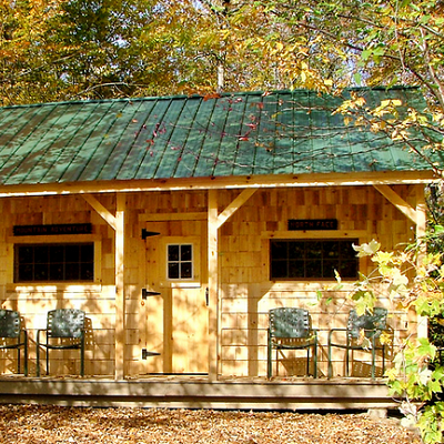 Welcome to a cozy shelter, which features proportional windows and a hinged, barn-like door. (Jamaica Cottage)