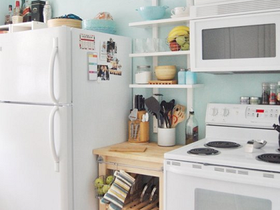 Cristin and Zach's kitchen fits right into their bungalow, and is important because they have a young child at home. We like the bright and light feel here. (Cristin and Zach, Apartment Therapy)