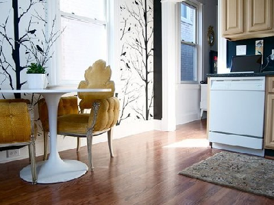 Emily has an eat-in kitchen, giving it style with cool yellow chairs and bare tree limb walls. We aren't surprised this home made the top four finalists in the Small Cool 2014 contest. (Emily, Apartment Therapy)
