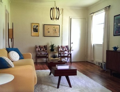 "Lauren's 923 sq. ft. home is located in Charlottesville, VA. She loves her cozy cottage, which is ""furnished mostly with vintage pieces and objects I've found in my travels. It makes my home feel very personal."" (Lauren, Apartment Therapy)"