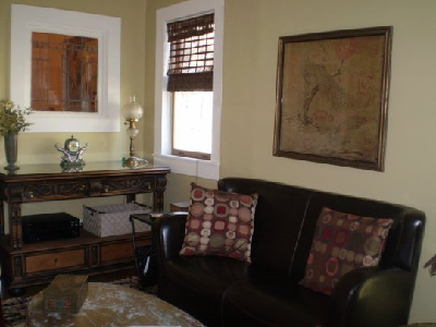"""Patricia's 500 sq. ft. home is located in N. Topsail Beach, NC. Converted from a 1907 residential auto garage, she decorated with """"elegant and primitive designs"""" to fit her Victorian home and neighborhood. (Apartment Therapy)"""