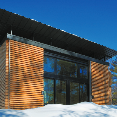 Here's the exterior of EDGE, a real energy-saving house. It starts with 480 sq. ft. of living space and north/south facing windows. (Revelations Architect)