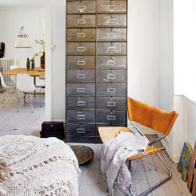 In Spain, a large office cabinet contains 20 drawers. All this bedroom storage is terrific, though may require a tall person to reach the top files. (Elle Spain)