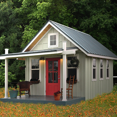PRE-FAB SUPPLIER: A welcoming, country style is seen in this tiny house. It features well proportioned windows, doors and an open front porch. The board and batten siding makes it feel authentic. Kanga's house measures 168 sq. ft. (Kanga Studio)