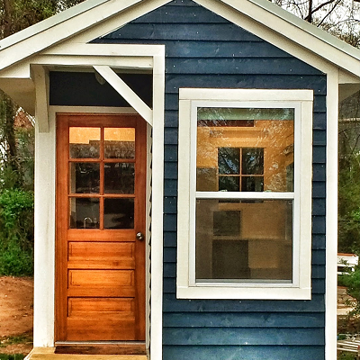 La Petite Maison looks great in blue and white, with a natural wood door. Originally built in Georgia, the tiny house recently relocated to Delaware. (La Petite Maison)