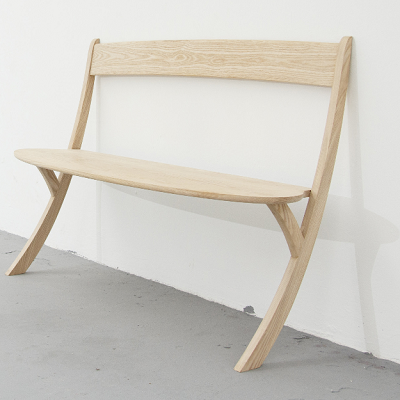 Does this Dutch piece work? An elegant bench holds at least two people, proving the physics of a wall-leaner. Still it suffers for beauty over comfort, and appears useful for short-term or secondary seating. (Izabela Boloz, designer)