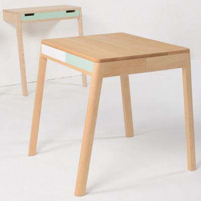 a lovebird consists of two wallleaning desks which connect drawers to form a standalone