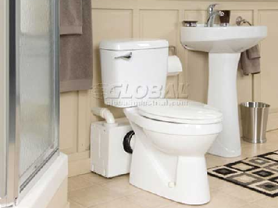 Here's a below-grade toilet with the macerator unit behind it. While not pretty, it gets the job done. (Thetford)