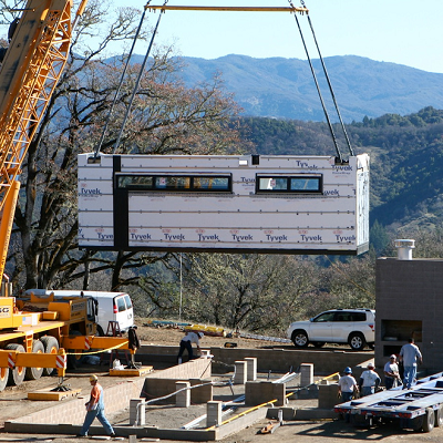 See a module craned into place, part of a prefab modern home in peaceful Ukiah, CA. (Marmol Radziner)