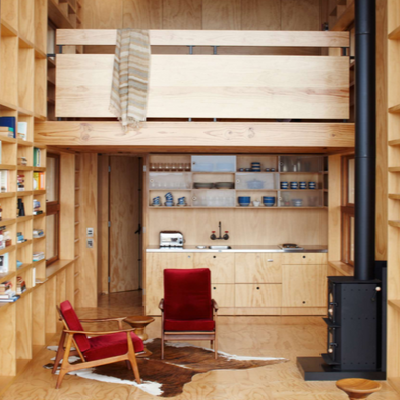 New Zealand Interior: In this beach-side place, there's nicely finished wood and shelves line all the walls! You'll find upscale appliances and treatments too. (Hut on Sleds)