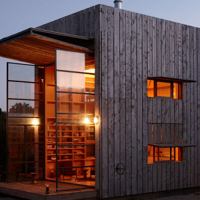 Architizer Jury Winner: New Zealand. An industrial and wood beach home is installed on sleds for moving. From architects Crosson Clarke Carnachan. (Hut on Sleds)