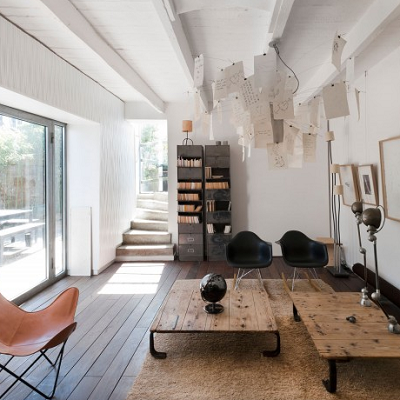 French designer Maurice Padovani renewed a Marseilles beach home with an industrial vibe. Two former office cabinets have positions of honor in this great room. (Homedsgn.com)