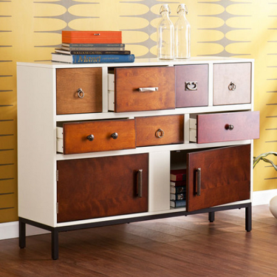 """Mid-century goes industrial in this new dresser with pewter, bronze and brass pulls. It could be used in a great room or bedroom. Measures 48"""" W x 15"""" D x 36.5"""" H. (Dot and Bo)"""