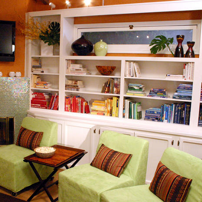 These built-in bookshelves use space well, surrounding a window. Do people really organize books by color? (HGTV)