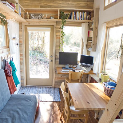 Even in a 240 sq. ft. tiny house, it's possible to create bookshelves on two or more interior walls. (The Tiny Project)