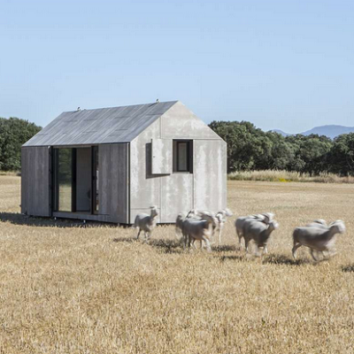 Architizer Popular Winner: Spain. This perfectly compact home has been placed in a large field, complete with sheep. From architect and builder Abiton. (Portable Home)