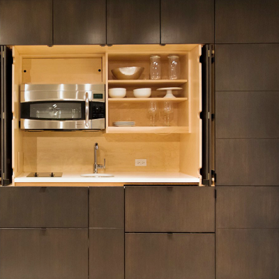 In six feet, a mini-kitchen could be installed without the whole wall unit. (Resource Furniture)