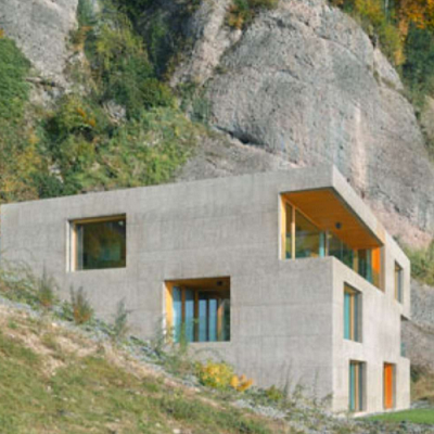 ARCHITECT: Imagine living somewhere special and getting this modern home approved. It's an exposed concrete cube tucked naturally into the mountainside. From architect Lischer Partner Architekten Planer. (Ferienhaus Vitznau)