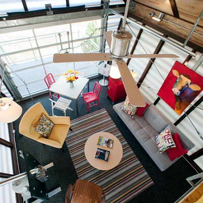 From the sleeping loft, you get a bird's eye view into the great room. It features plenty of comfortable seating for such a tiny house. (Broadhurst)